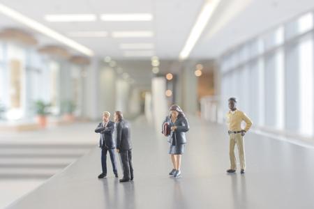 mini figures people walking in the office corridor.