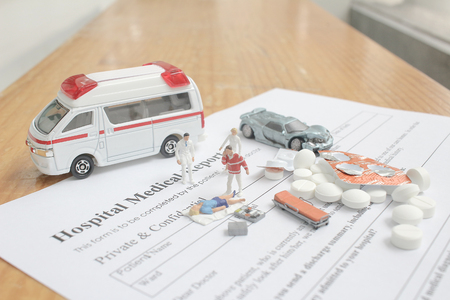 mini figure with hospital medical report