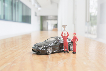 driver mini figure with cup at the background Editorial
