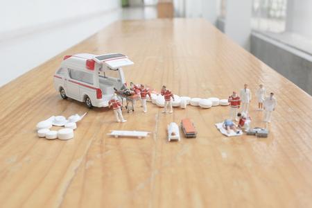 mini figure of first aid and ambulance Stock Photo