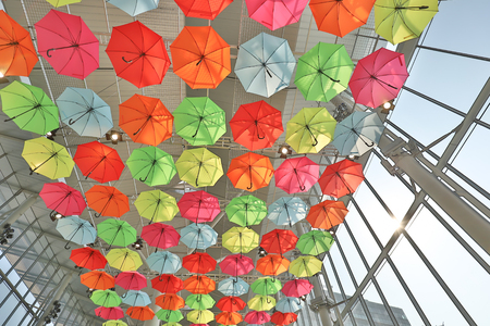 many colorful umbrellas in street decoration. 免版税图像