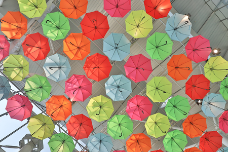 many colorful umbrellas in street decoration. Stock Photo