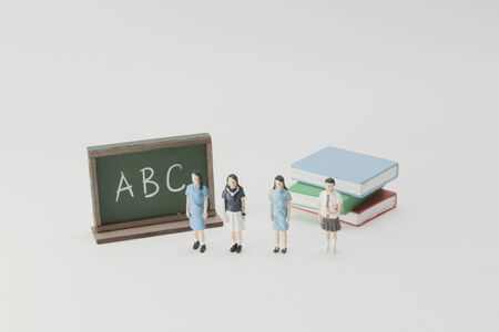 an elementary education and mini figure of student.