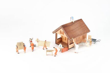 mini figure of workers move the house
