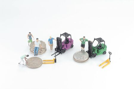 Mini figure of Man Moving A Stack Of Coins