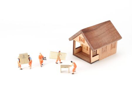 a mini figure of workers move the house 스톡 콘텐츠