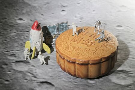 figure toys of spacemen walk on the moon cake, concept of moon cake festival