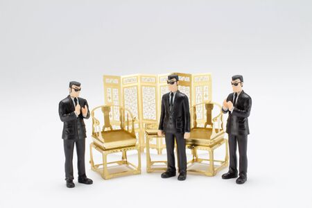 mini figure of gangster with antique chair and table