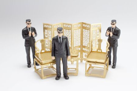 the mini figure of gangster with antique chair and table