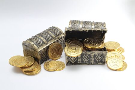 the boxes of gold coins at the with back ground