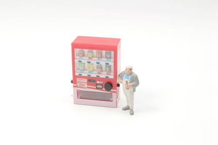 mini figure buy drinks from vending machines.