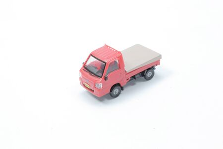 the red scale truck miniature on white back ground Stock fotó