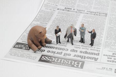 a Figure on a newspaper, the business world Stock fotó