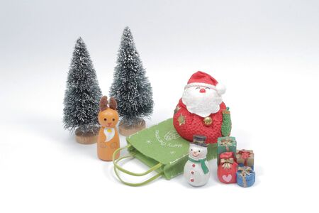 a Christmas composition. Gifts, fir tree branches, red decorations on white background.  Stok Fotoğraf