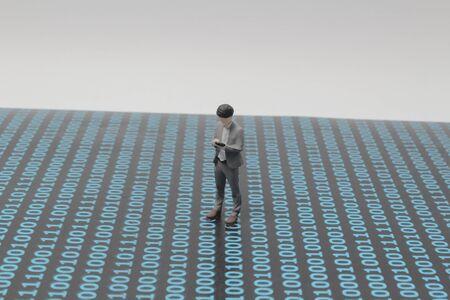 a cyber figure concept looking the moble phone Banco de Imagens - 132117529