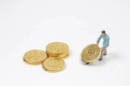 the mini people pulling stack coins using for logistic. Banco de Imagens - 151035421