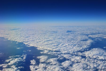 White clouds in the sky from air view Imagens