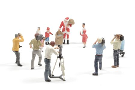 figure toy of shooting production crew team with Santa Claus , concept image of Christmas film maker