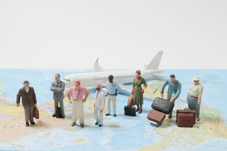 mini figure toy of Business Travelers Standing On A Map, concept of traveling