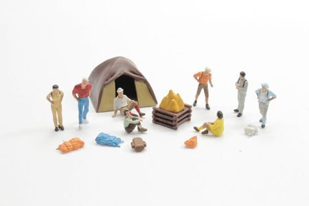 Mini people travelers or backpackers , using as background travel or business concept.