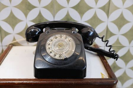 the Old black telephone on  woodent table 11 Feb 2020
