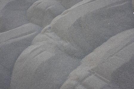 Zen garden stone on black sand with pattern. 9 June 2008 Stock Photo