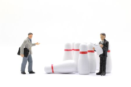 the tiny of Business people Figurines and Bowling Ball Imagens