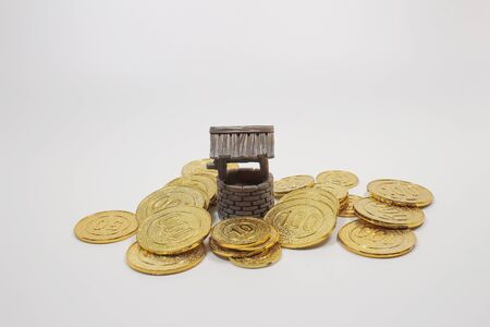 a scale of wish well with a few coins.