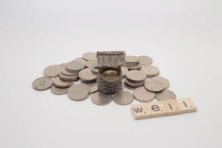 The scale of wish well with a few coins.