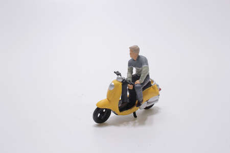 the fun of figure stand with the motorcycle Stock Photo