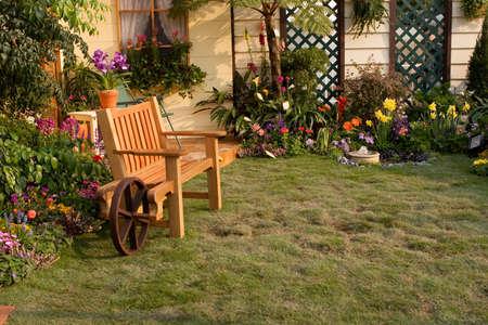 a Landscaped backyard flower garden, Multicolored flowerbed on a lawn