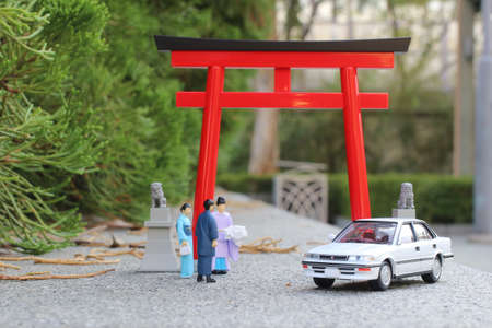 the scale of figure Kannushi man with Torii gate Stock Photo