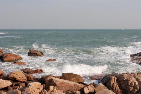 a rocky sea coast and blurred water in shek o Imagens