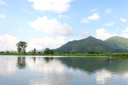 the Reflection of the Kai Kung Leng, at Shan Pui Tsuen fish pond. Stock fotó