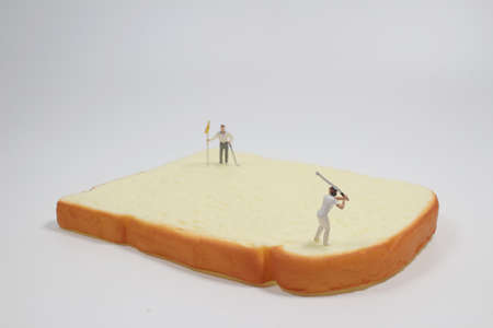 the mini figure play the golf on on Bread