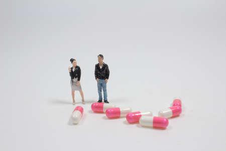 the mini of fun people posing in front of pills