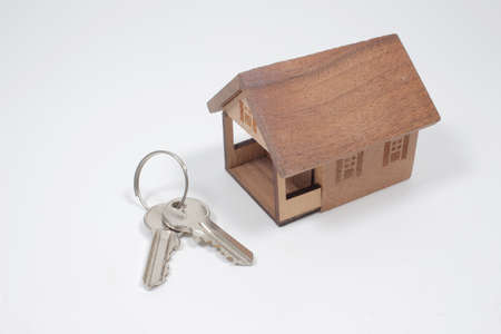 the mini of wood house with silver key