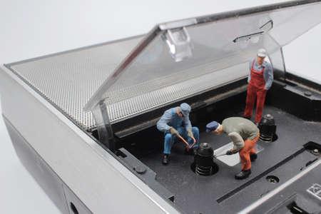 a mini figure dolls engineer fix recorder