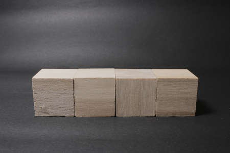 the wooden cube isolated on a dark background 版權商用圖片