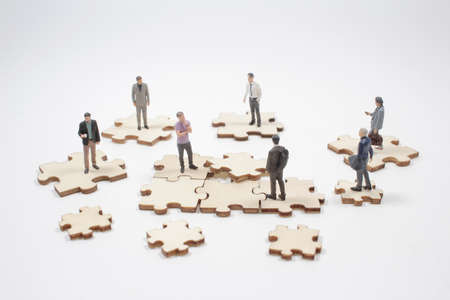 Business teamwork with puzzle finishing project cooperation unity concept.