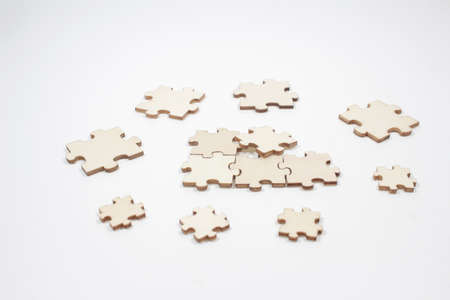 jigsaw puzzle and a pile of uncombed puzzle elements against the background