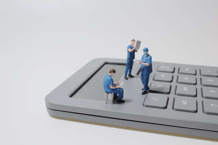 the mini doctor sits on a calculator, Health care cost