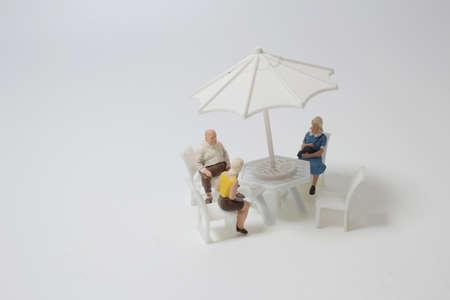 a mini figure sitting on Outdoor furniture