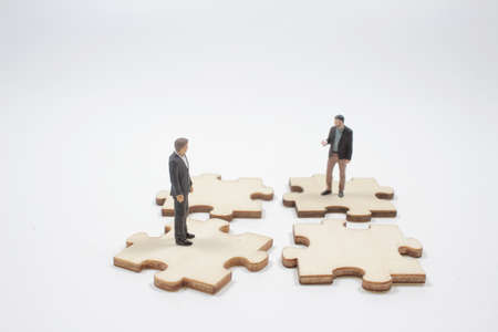 Business teamwork with scramble puzzle cooperation unity support concept 版權商用圖片