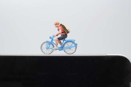 Bike cycling trainer and tracing app. A cycling above smartphone