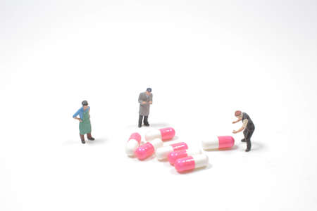 the mini of fun people workers moving capsules pills