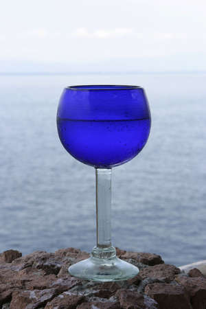 Blue Water Goblet With Ocean Background