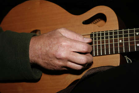 making music: Guitar and Hand Making Music