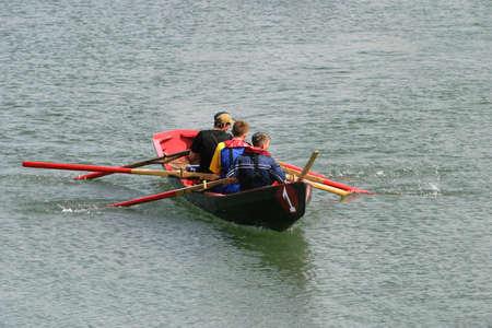Aran Island men rowing in a race