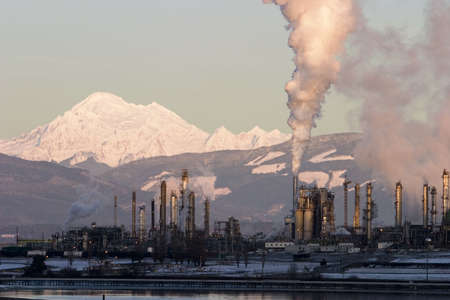 smokestacks: An oil refinery in operation near Mt. Baker in Washington State. Stock Photo